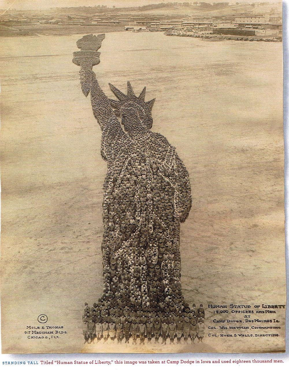 1918. Group photograph of 18,000 U.S. servicemen posing in formation to represent the Statue of Liberty. Camp Dodge, Des Moines, Iowa.jpg