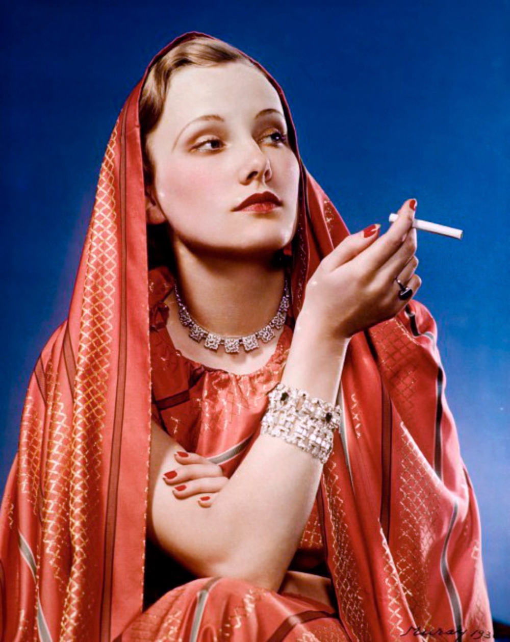 1936. Girl in Red advertisement for Lucky Strike; shot by Nickolas Muray, a photographer enlisted by Bernays to help popularize feminine thinness and cigarette smoking.jpg