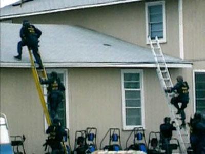 1993. Mount Carmel Center fire. Waco Siege. Inside Waco ATF roof.jpg