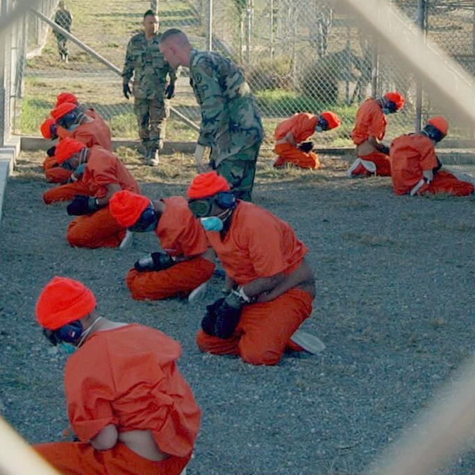 2002. Detainees at Camp X-Ray (11 January).jpg