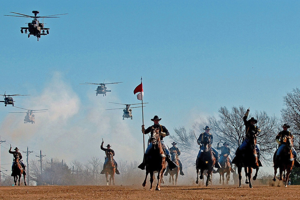 2008. Ist Cavalry Division Horse Detachment perform a cavalry charge accompanied by a helicopter flyover performed by the Ist Cavalry Division Air Cavalry Brigade on Fort Hood's Cooper Field, Texas, 12 Dec..jpg