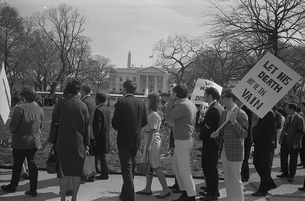 Demonstrators_with_signs,_one_reading_Let_not_his_death_be_in_vain.jpg